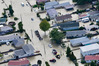 Aerial photo of agricultural vehicles being used to help evacuate Edgecumbe people to welfare centres established. A benefit concert is being held to help people affected by the flooding. Photo/file