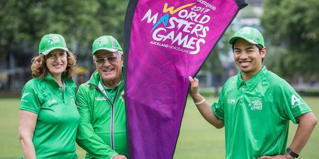 They're of World Masters Games 2017 volunteer ambassador and former All Black Bryan Williams with event volunteers. Photo / Supplied.