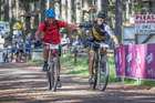 Olympian Rod Dixon (USA, Right) celebrates finishing the World Masters Games Male Mountain Bike race with fellow competitor Nicholas Devcich (NZL). Photo / Greg Bowker