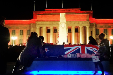 Family sit with Francis Toko's casket at the Dawn Service on the Auckland Domain. He died on Monday and his family wanted to bring him to his last-ever dawn parade. Photo/Gerrie Toko-Mikahere