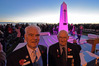Light dawns on the Mount Maunganui cenotaph at this year's Anzac Day service with Mount Maunganui RSA's Peter Moss and president Derek Williams taking part. Photo/George Novak