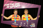 The Whanganui Rush sisters Jacs (left) and Steph head to the World Masters Games photo booth after winning silver in the Womens' C Grade (42-50yrs) Double Sculls on Lake Karapiro.
