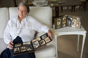 Angela Caughey (formerly Angela Ruxton Wilson) with her family photographs after discovering how her second brother, Sub-Lieutenant Ian Lewis Ruxton Wilson, was killed in WW II. Photo / Nick Reed