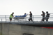 Emergency services transport the injured Frenchwoman from the rooftop helipad into Dunedin Hospital yesterday. Photo / Otago Daily Times