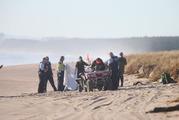 Emergency services at Papamoa Beach where a body was found. Photo/John Borren