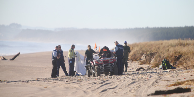 Emergency services at Papamoa Beach where a body was found. Photo/John Borren