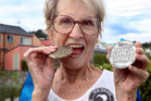 Mavis Carter, 81, with her gold and silver from the World Masters Games.