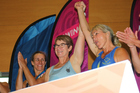 Phillipa Baker-Hogan, middle, raises hands with Brenda Lawson after they claimed Double Scull's gold at the World Masters Games.