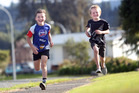 Noah Fisher, 9, (left) and Will Fisher, 7, will pound the pavement in the Rotorua Mini Marathon next week. PHOTO/BEN FRASER