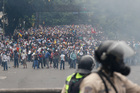 Opponents of President Nicolas Maduro march in Caracas, Venezuela. Photo / AP