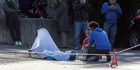 A white sheet covers Astana cyclist Michele Scarponi and his bicycle after he was hit by a van while training, in Filottrano, near Ancona, central Italy. Photo / AP.