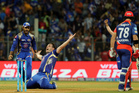 Mumbai Indians Mitchell McClenaghan, centre, celebrates after claiming Corey Anderson's wicket. Photo / AP