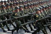 Soldiers carry rockets across Kim Il Sung Square during a military parade. Photo / AP