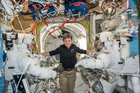 Astronaut Peggy Whitson, center, floats inside the Quest airlock of the International Space Station. Photo / AP