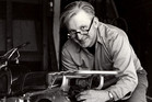 Zen and the Art of Motorcycle Maintenance author Robert M. Pirsig working on his motorcycle in 1975. He died at his home in South Benwick, Maine, today. Photo / William Morrow via AP