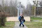 Journalists take a selfie in front of the monument of Soviet state founder Vladimir Lenin in Chernobyl, Ukraine. Photo / AP
