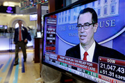 US Treasury Secretary Steven Mnuchin appears on a television screen on the floor of the New York Stock Exchange today as he announces President Donald Trump's dramatic proposed tax cuts. Photo / AP