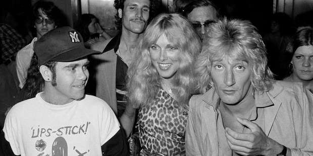 A young Elton John, left, Lana Hamilton and Rod Stewart arrive at New York's Studio 54 in July, 1978. Photo / AP