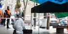 Police and forensics at the scene of a cordon on Queen St. New Zealand Herald Photograph by Jason Oxenham.