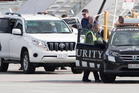 Top secret: FBI director James Comey disembarks from a Gulfstream jet at Queenstown Airport early on Sunday morning. He was believed to be en route to Millbrook Resort, Arrowtown for a highly secretive Fives Eyes conference. No plainclothes police dogs are evident in this picture. Photo/NZME