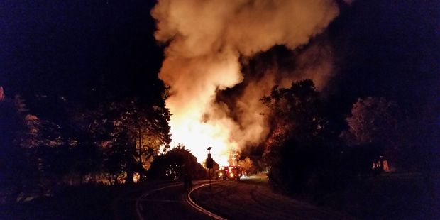 The skies were set alight by a blaze, which burned the Olivers' house to the ground, in Mauriceville. Photo /Nicky Vegar