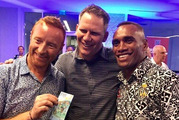 Ben Ryan, the coach who led the Fijian sevens team to Olympic victory, Bruce Southwick, and captain Osea Kolinisau at the launch of a $7 note featuring Mr Southwick's photos.