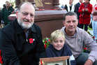 Kevin Grose with great nephew Liam, 11, and nephew David holding an image of their uncle Francis Thorburn who was killed in Italy during World War II.