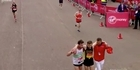 Watch: Watch: Exhausted London Marathon runner helped over finish line in show of sportsmanship