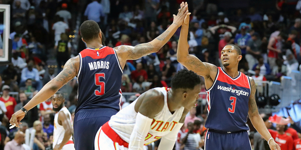Washington Wizards Markieff Morris and Bradley Beal celebrate their victory over the Atlanta Hawks