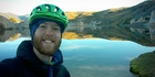 Lewis Brindley, here at the Blue Lake in St Bathans, is reaching the end of his 3000km NZ-long mountain bike ride.