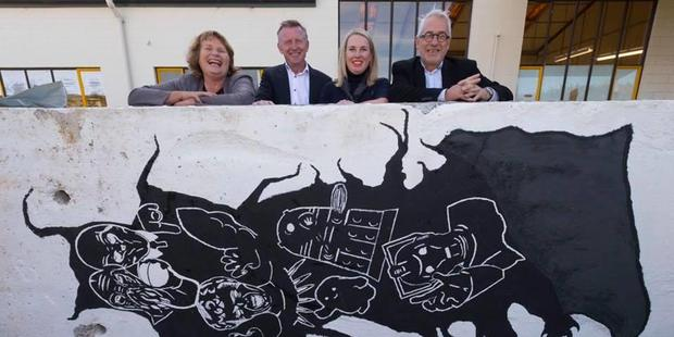 City Councillor Vicki Buck, Southbase Construction CEO Quin Henderson, SCAPE Public Art director Deborah McCormick and city council development director Peter Vause with part of the Berlin Wall.