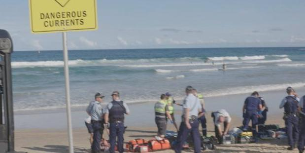 Loading Rescuers work frantically on the unconscious swimmers. A woman was saved. Her husband could not be revived. Photo / Channel 10