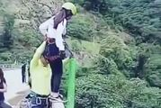 A young woman's bungee-jump off a 50ft (15m) bridge in Bolivia ended in disaster. Despite safety checks, the rope brake failed. Photo / LiveLeak