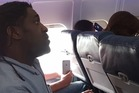 Kima Hamilton was filmed being kicked off a Delta flight last month because he used the bathroom during a delay on the tarmac. Photo/YouTube