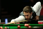 Unfulfilled English talent Judd Trump is always fashionably coiffured and shod. Photo / AP