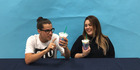 Cam and Bailee try the Unicorn Frappuccino.
