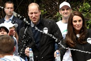 Prince William and Kate Middleton were almost soaked by a London marathon runner who sprayed them with water as they watched the race - but Kate seemed less than impressed. Photo/Getty Images