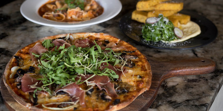 Prosciutto al fungi pizza and pappardelle pasta from Papa's Italian Eatery. Photo / Dean Purcell