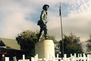 The sature of Captain Charles Upham overlooks World War I memorial crosses in Amberley, North Canterbury.