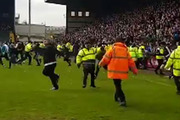 Steward sacked after tripping rival fans