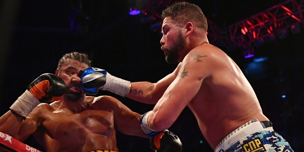 Tony Bellew (blue trunks) has his eyes on Joseph Parker after upsetting David Haye (left). Photo / Getty Images