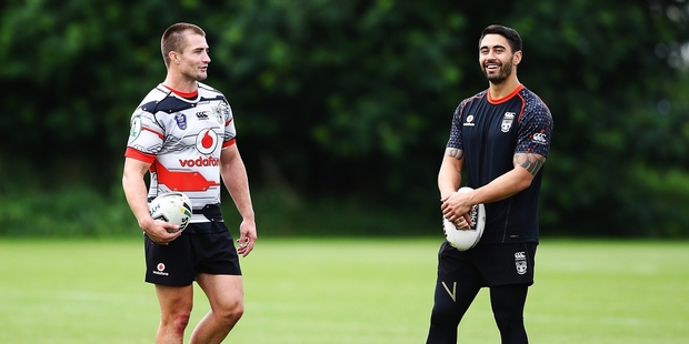 Kieran Foran (left) and Shaun Johnson are part of an all-Warriors spine for the Kiwis tonight. Photo / Getty Images