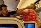 Two men started a fight on a plane as other horrified passengers looked on. Photo/Twitter/Keem