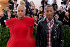 It's hard to focus on the NZME merger decision when Pharrell Williams' wife Helen Lasichanh hits the Met Gala looking like an armchair. Photo / AP