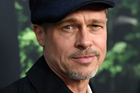 Brad Pitt says he wanted to 'cling' to Angelina Jolie after she filed for divorce, but now realises he needs to let her go. Photo/AP