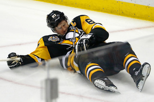 Pittsburgh Penguins' Sidney Crosby lies on the ice after taking a hit. Photo / AP