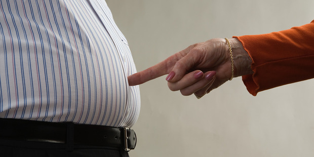 Weight gain in middle-age may be due to one particular enzyme- and there's a possible cure! Photo / Getty Images