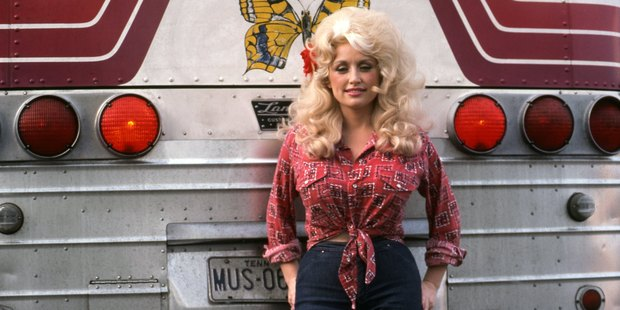 Country Singer Dolly Parton poses for a portrait by her tour bus before performing in September 1977 in Detroit. Photo / Getty
