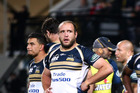 The Brumbies players look on in disappointment after letting in a Hurricanes try. Photo / Getty