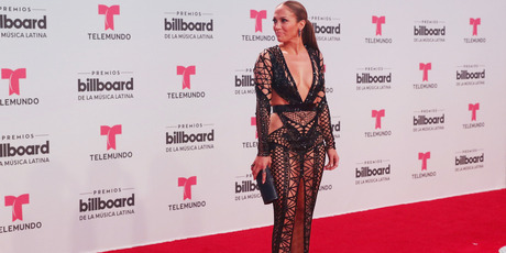 J Lo was definitely eye-catching in this barely-there dress. Photo / Getty